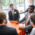 Employers socialize with students during on campus interview week at UF Law.