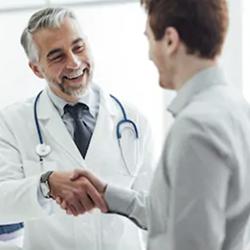 doctor shakes patient hand